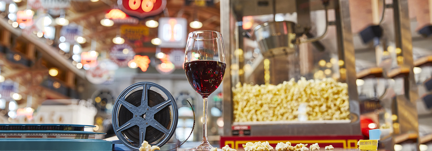 Wine glass with film reel and popcorn