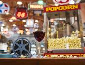 Film reel, wine glass and popcorn